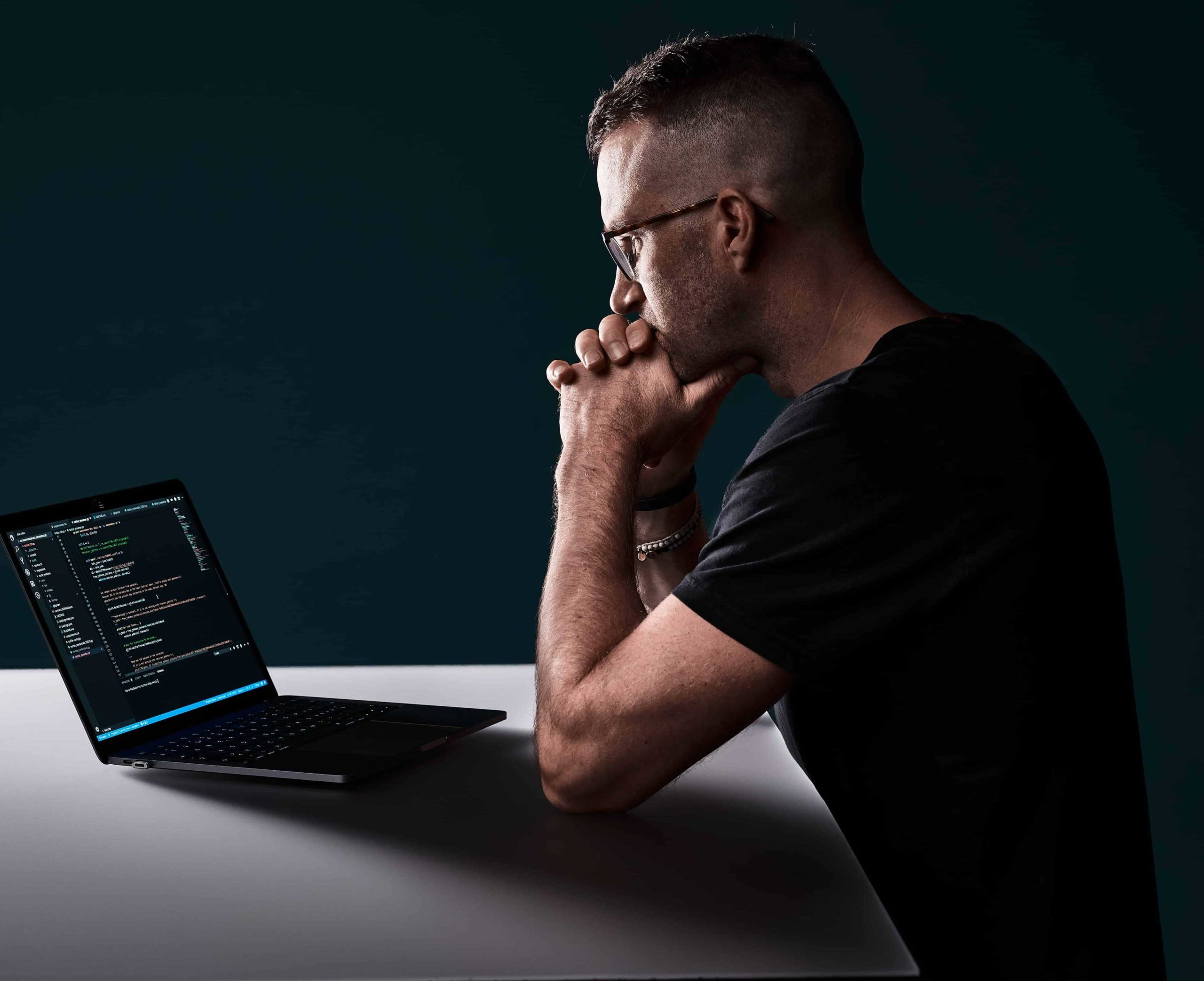 marc-steiner-is-sitting-in-front-of-laptop-and-coding